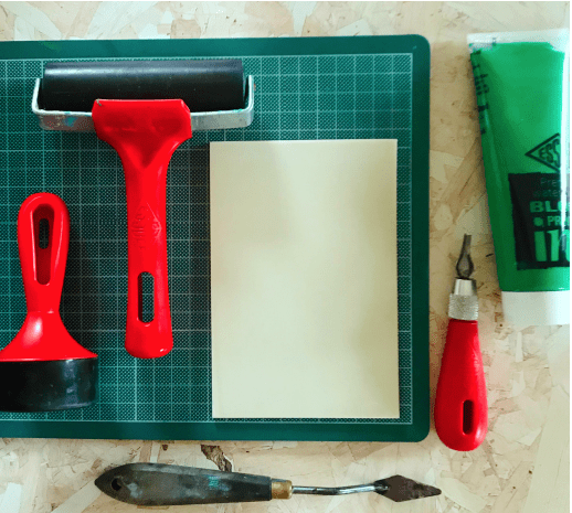 Essdee red handles roller, brayer, piece of SoftCut and green block printing ink