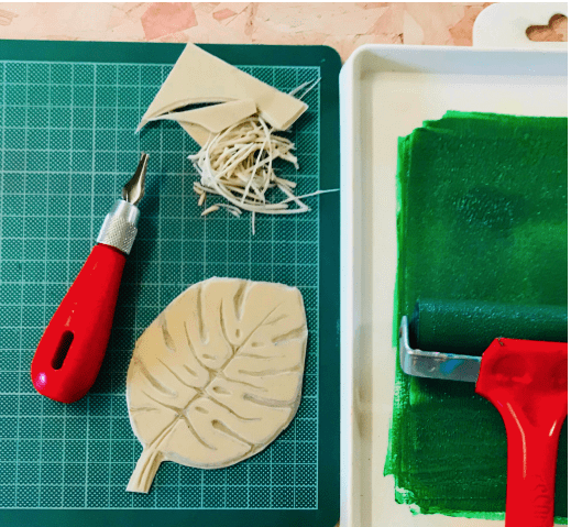 monstera leaf carved onto SoftCut, ink tray with green block printing ink