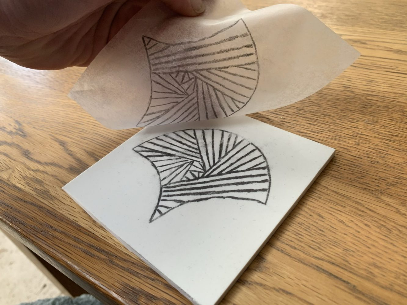 Fan image being transferred from tracing paper onto softcut material