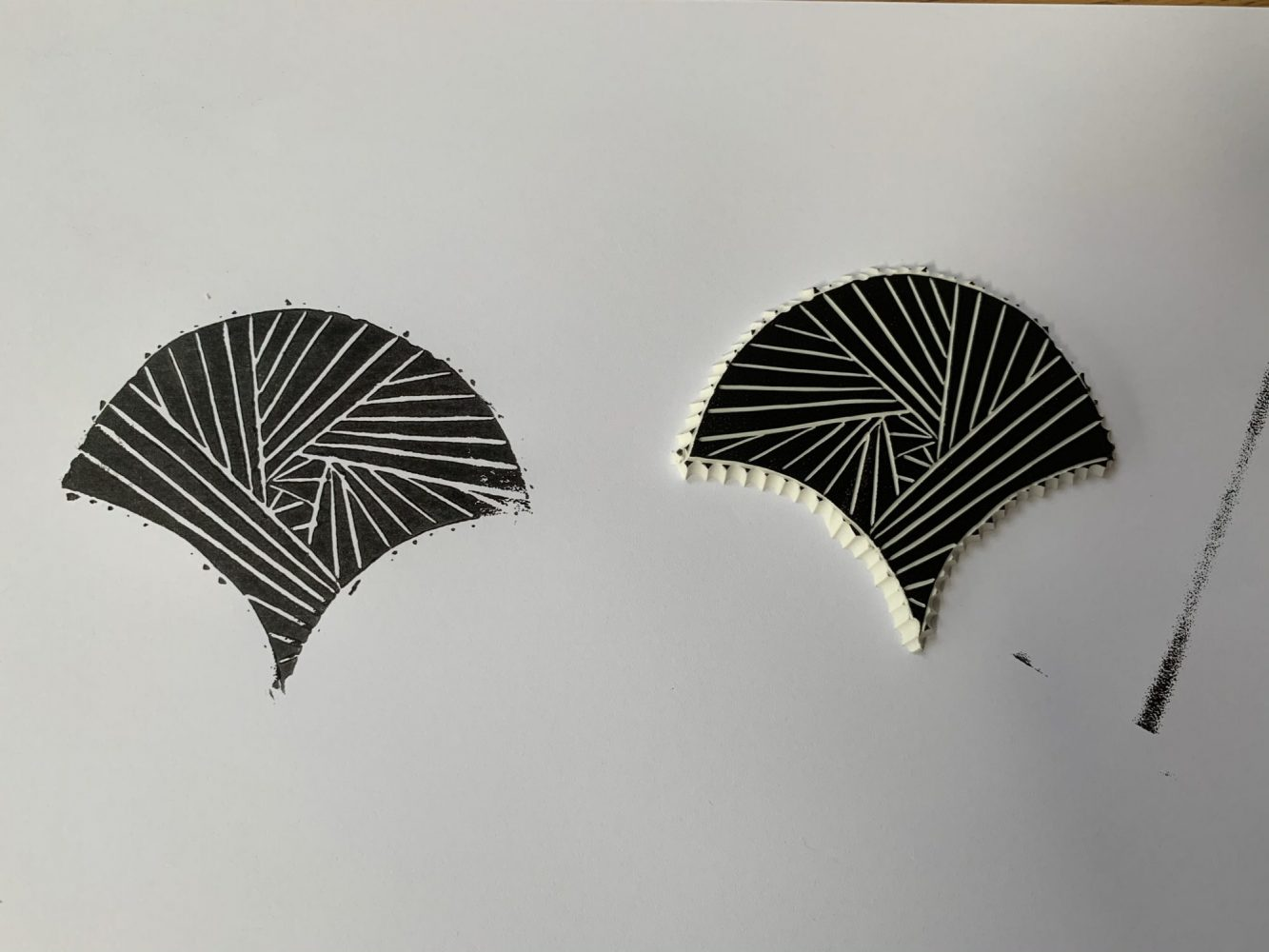 Fan image printed in black onto paper next to mastercut stamp
