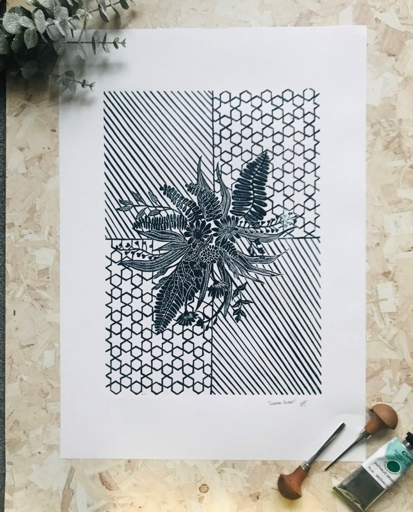 Black and white flower lino print on geometric background