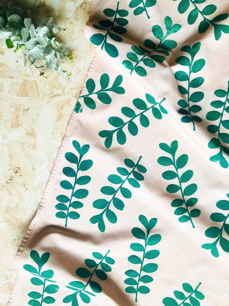 Cream fabric with green printed leaves